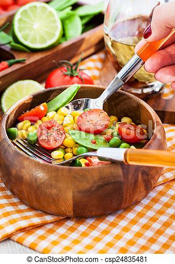 Fresh salad with corn, peas, tomato and chilli - csp24835481