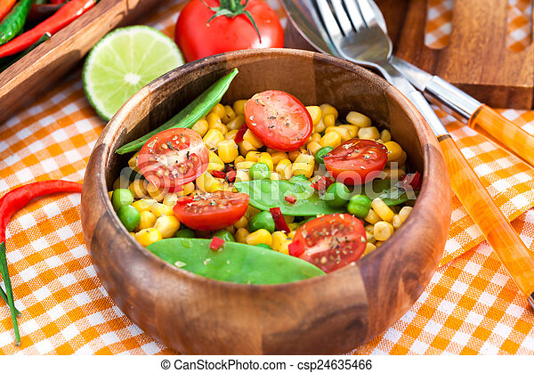Fresh salad with corn, peas, tomato and chilli - csp24635466