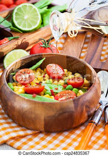 Fresh salad with corn, peas, tomato and chilli - csp24835367