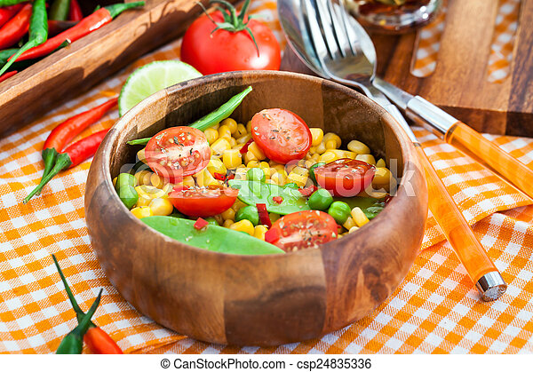 Fresh salad with corn, peas, tomato and chilli - csp24835336