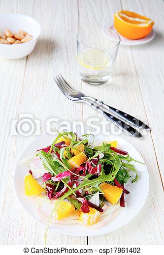 fresh salad with orange slices - csp17961402