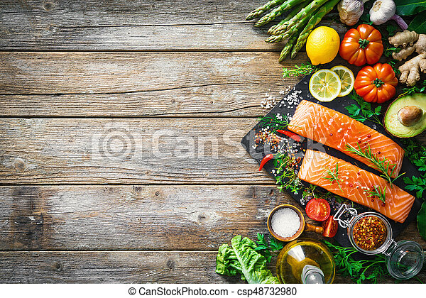 Fresh salmon fillet with aromatic herbs, spices and vegetables - csp48732980