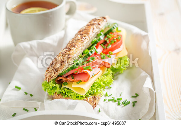 Fresh sandwich with cheese, ham and cucumber for breakfast - csp61495087