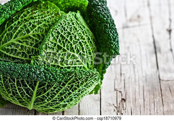 fresh savoy cabbage closeup - csp18710979