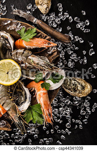 Fresh seafood on crushed ice. - csp44341039