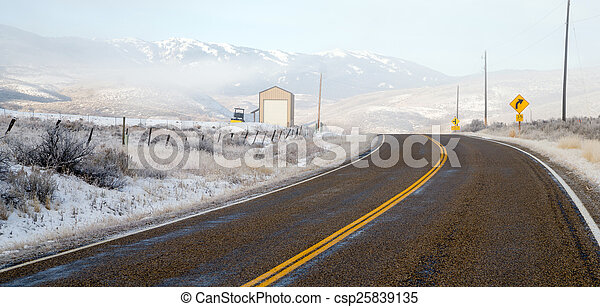 Fresh Snow Blankets Hillside Rural Country Scene Two Lane Road - csp25839135