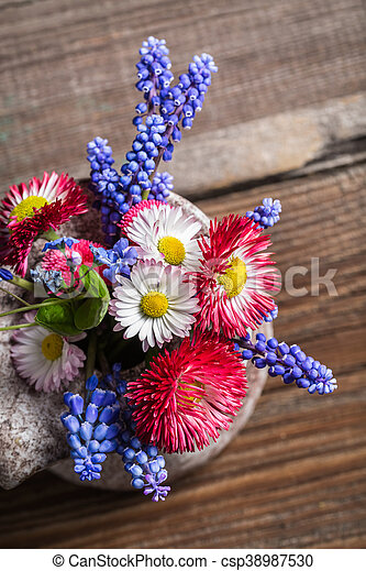 Fresh spring flowers in a vase - csp38987530