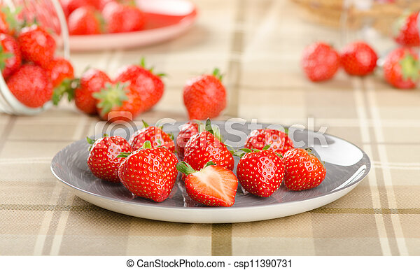 fresh strawberries on a plate - csp11390731