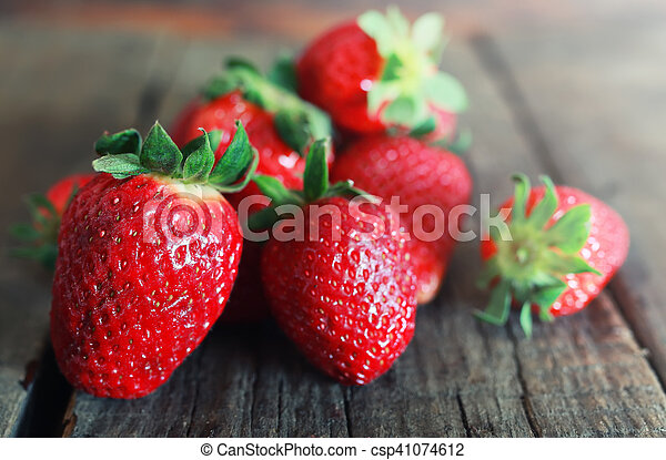 fresh strawberries on a wooden background - csp41074612