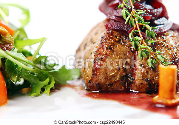 Fresh tasty meat with gourmet garnish - csp22490445