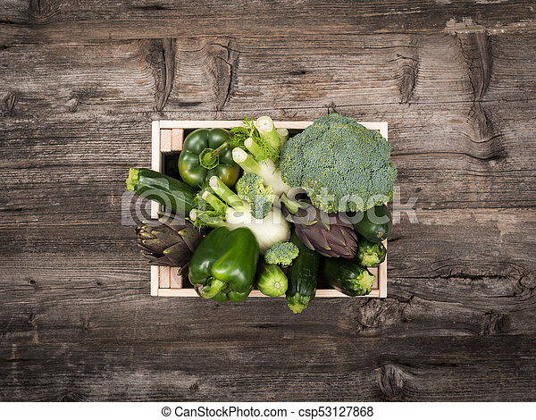 Fresh tasty vegetables in a wooden crate - csp53127868