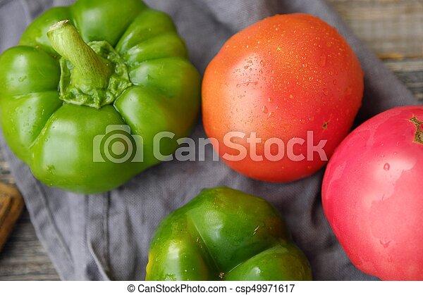 Fresh tasty vegetables on wooden background view - csp49971617