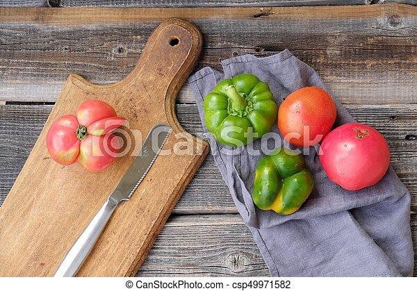 Fresh tasty vegetables on wooden background view - csp49971582