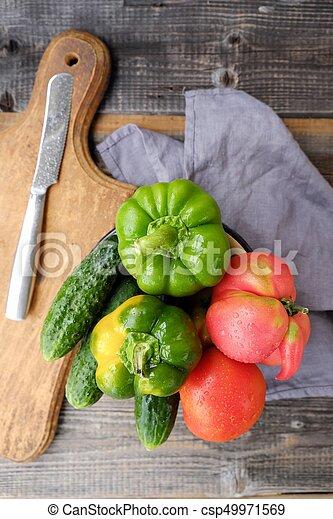Fresh tasty vegetables on wooden background view - csp49971569