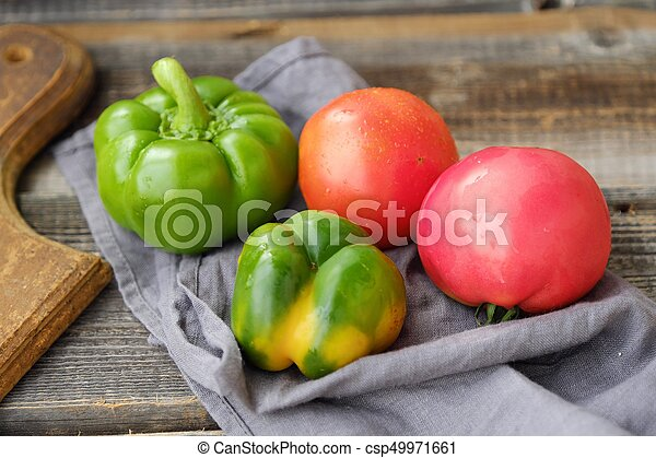 Fresh tasty vegetables on wooden background view - csp49971661
