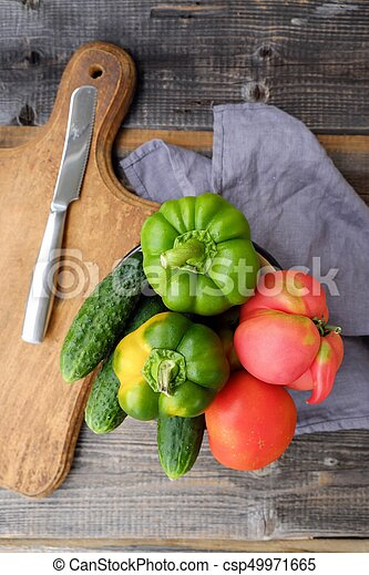 Fresh tasty vegetables on wooden background view - csp49971665