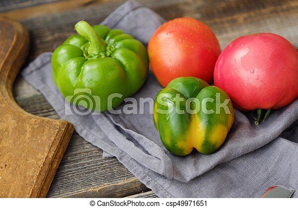 Fresh tasty vegetables on wooden background view - csp49971651