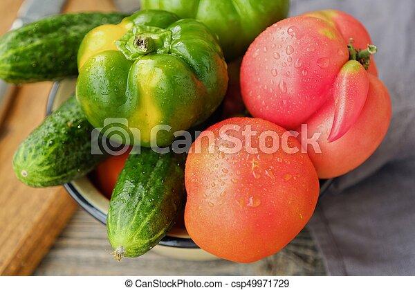 Fresh tasty vegetables on wooden background view - csp49971729