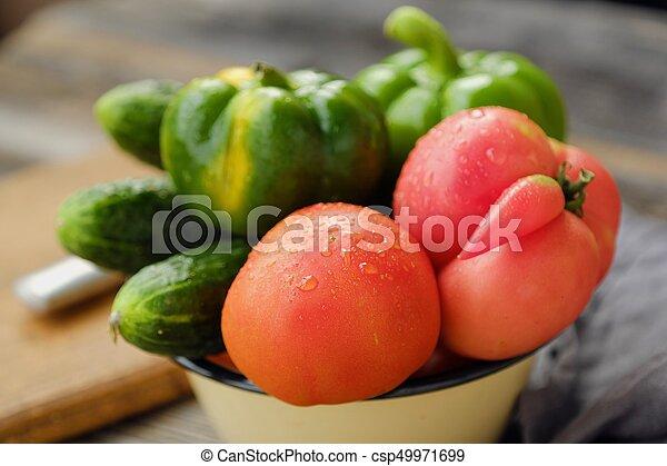 Fresh tasty vegetables on wooden background view - csp49971699