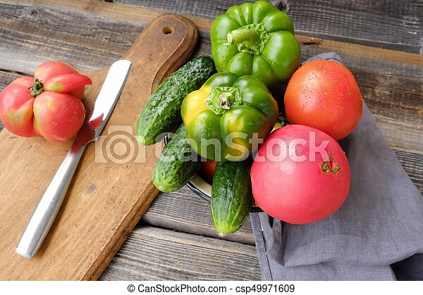 Fresh tasty vegetables on wooden background view - csp49971609