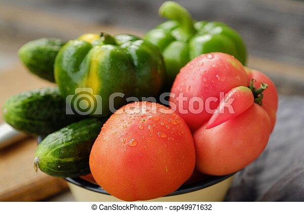 Fresh tasty vegetables on wooden background view - csp49971632