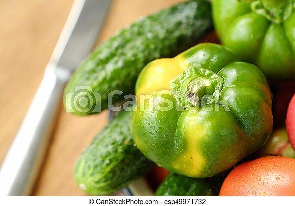 Fresh tasty vegetables on wooden background view - csp49971732