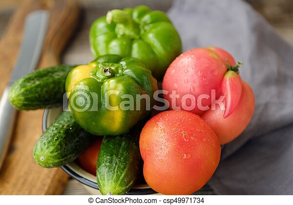 Fresh tasty vegetables on wooden background view - csp49971734