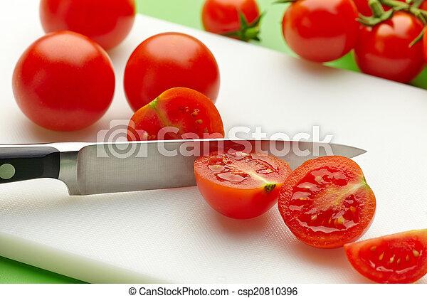 fresh tomato on cutting board - csp20810396