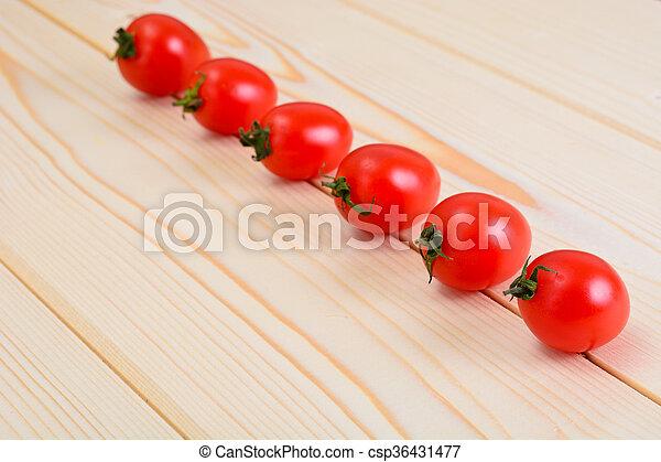 Fresh Tomato on Wooden Background. - csp36431477
