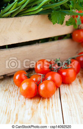 fresh tomatoes and onions in a wooden crate - csp14092520