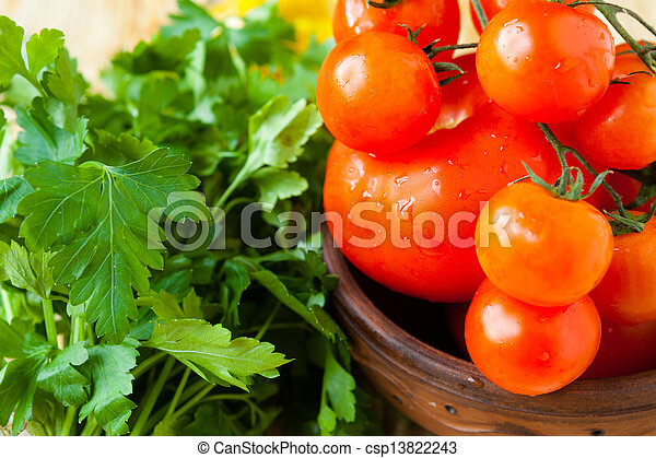 Fresh tomatoes in a bowl - csp13822243