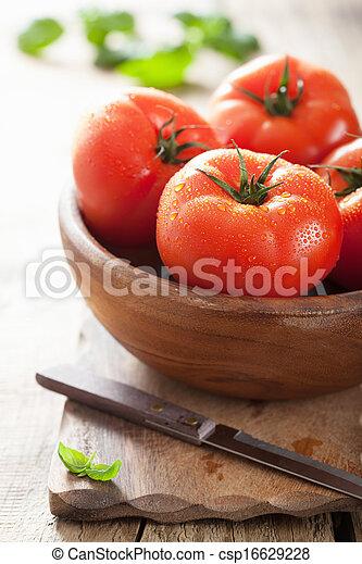 fresh tomatoes on cutting board - csp16629228