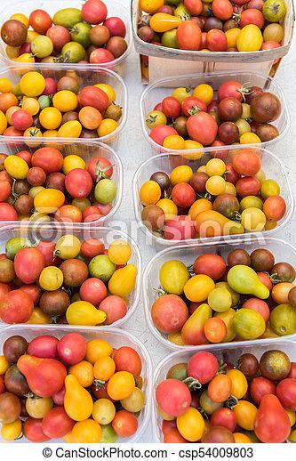 Fresh tomatoes, Organic Ripe various tomatoes in market - csp54009803