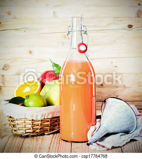 Fresh tropical fruit juice in a glass bottle - csp17764768