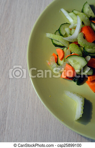fresh vegetable salad on a plate - csp25899100