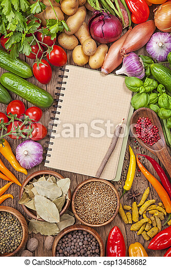 Fresh vegetables and blank recipe book - csp13458682
