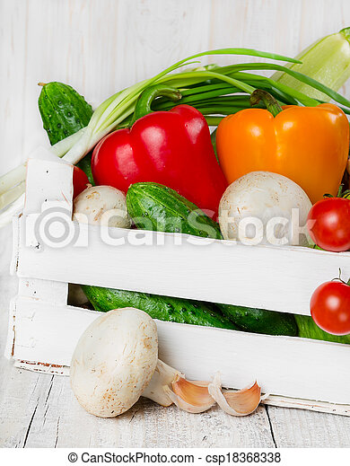 Fresh vegetables in a wooden box - csp18368338