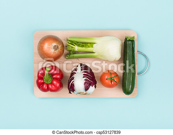 Fresh vegetables on a wooden chopping board - csp53127839