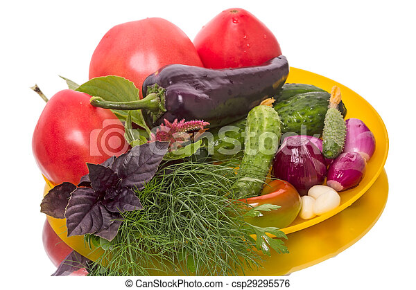 Fresh vegetables on a yellow plate isolated on white ...