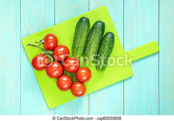 Fresh vegetables on cutting board - csp60555808