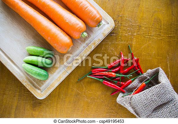 Fresh vegetables on wooden background - csp49195453