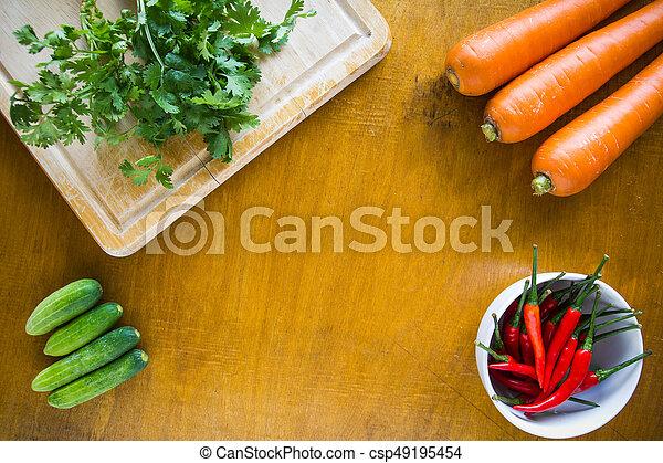 Fresh vegetables on wooden background - csp49195454