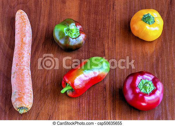 Fresh vegetables on wooden background - csp50635655