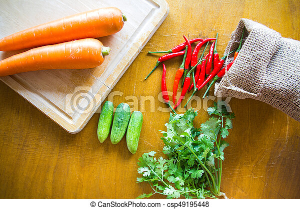 Fresh vegetables on wooden background - csp49195448