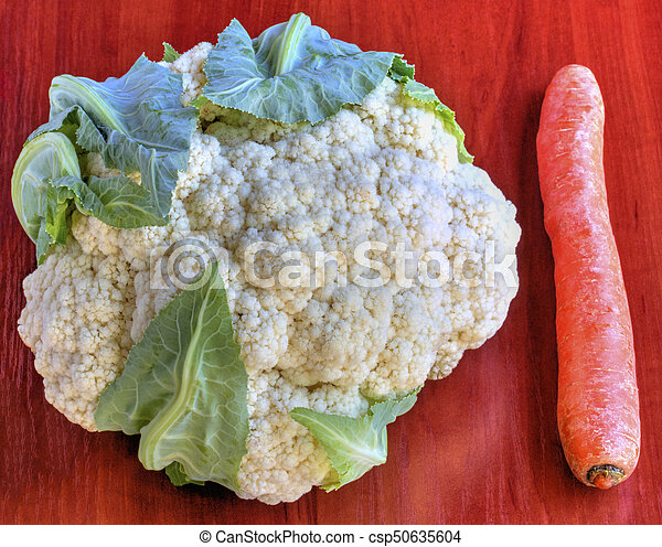 Fresh vegetables on wooden background - csp50635604
