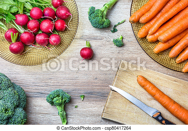 Fresh vegetables on wooden table - csp80417264