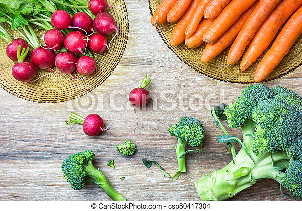 Fresh vegetables on wooden table - csp80417304