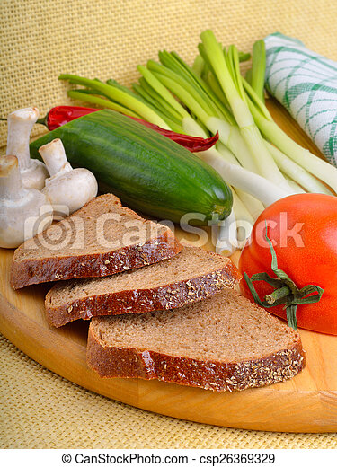 Fresh vegetables with bread - csp26369329