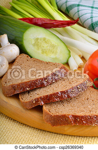 Fresh vegetables with bread - csp26369340