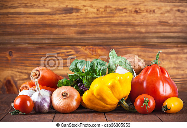 Fresh vegetables with bunch basil in wooden board copyspace
